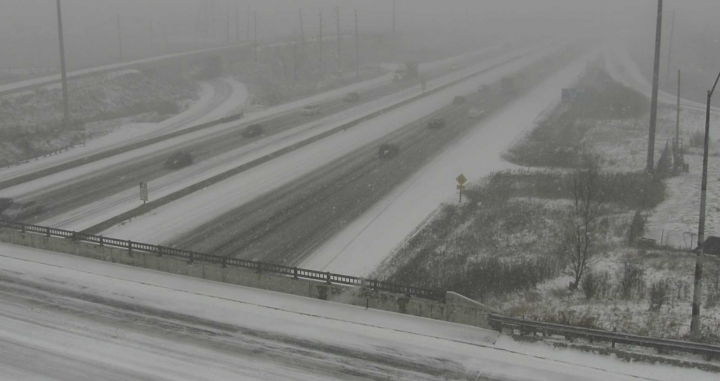 Snow-covered roads are seen at Highway 403 and Winston Churchill Boulevard Tuesday morning.