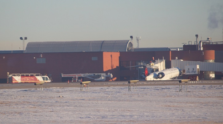 Air Canada flights from Regina to Vancouver and Toronto were delayed Friday morning after a catering truck got stuck under the nose of a CRJ900 aircraft at the Regina airport.