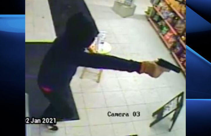Police say the suspect was wearing a dark blue hoodie, dark pants, tan-coloured gloves and black shoes with white trim.