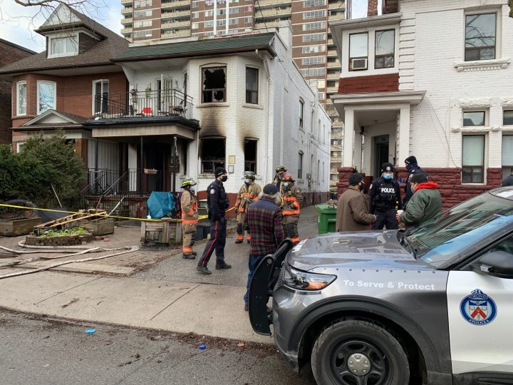 Emergency crews at the scene of a house fire in the area of Roncesvalles Avenue and Queen Street West on Sunday.