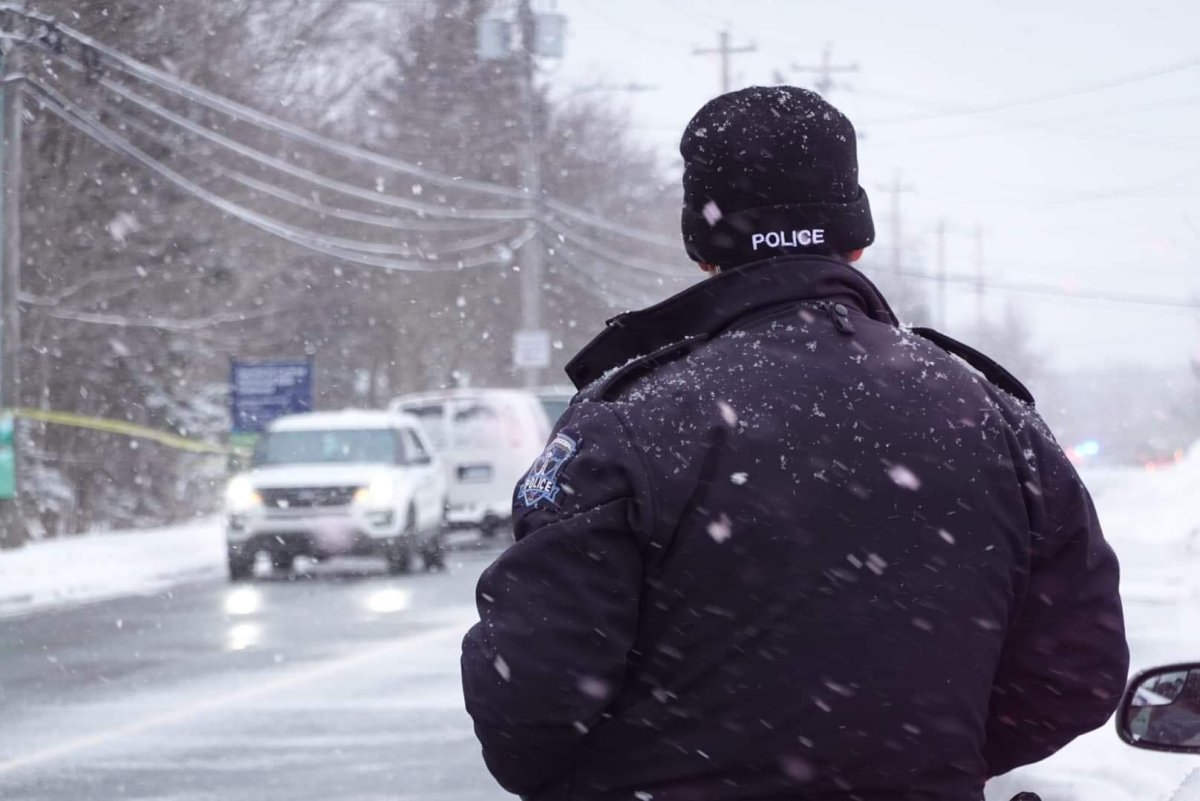 File - A Halifax Regional Police officer at the scene of a shooting near the intersection of Mount Edward Rd. and Cranberry Crescent on Feb. 20, 2021.