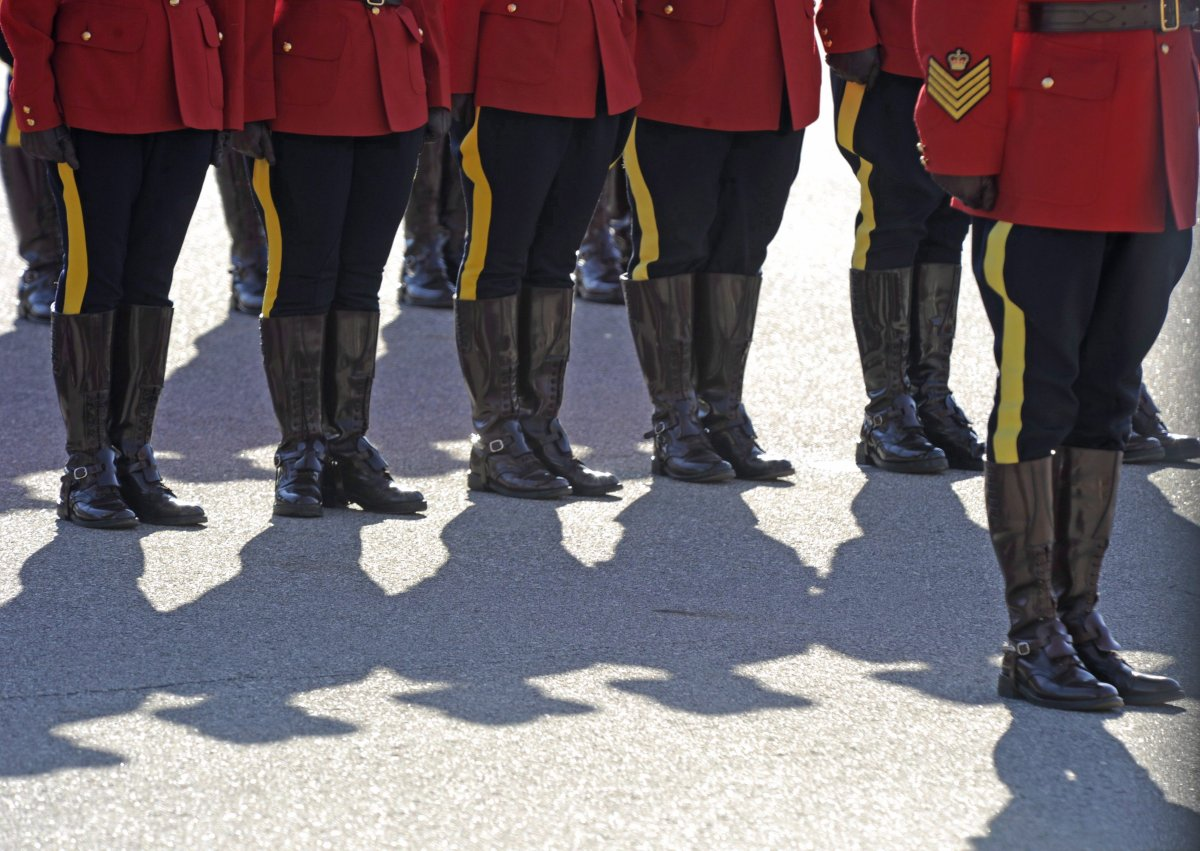 RCMP officers line up before a memorial for fallen mounties at RCMP Depot in Regina, Sask., on Sunday, Sept. 13, 2015.
