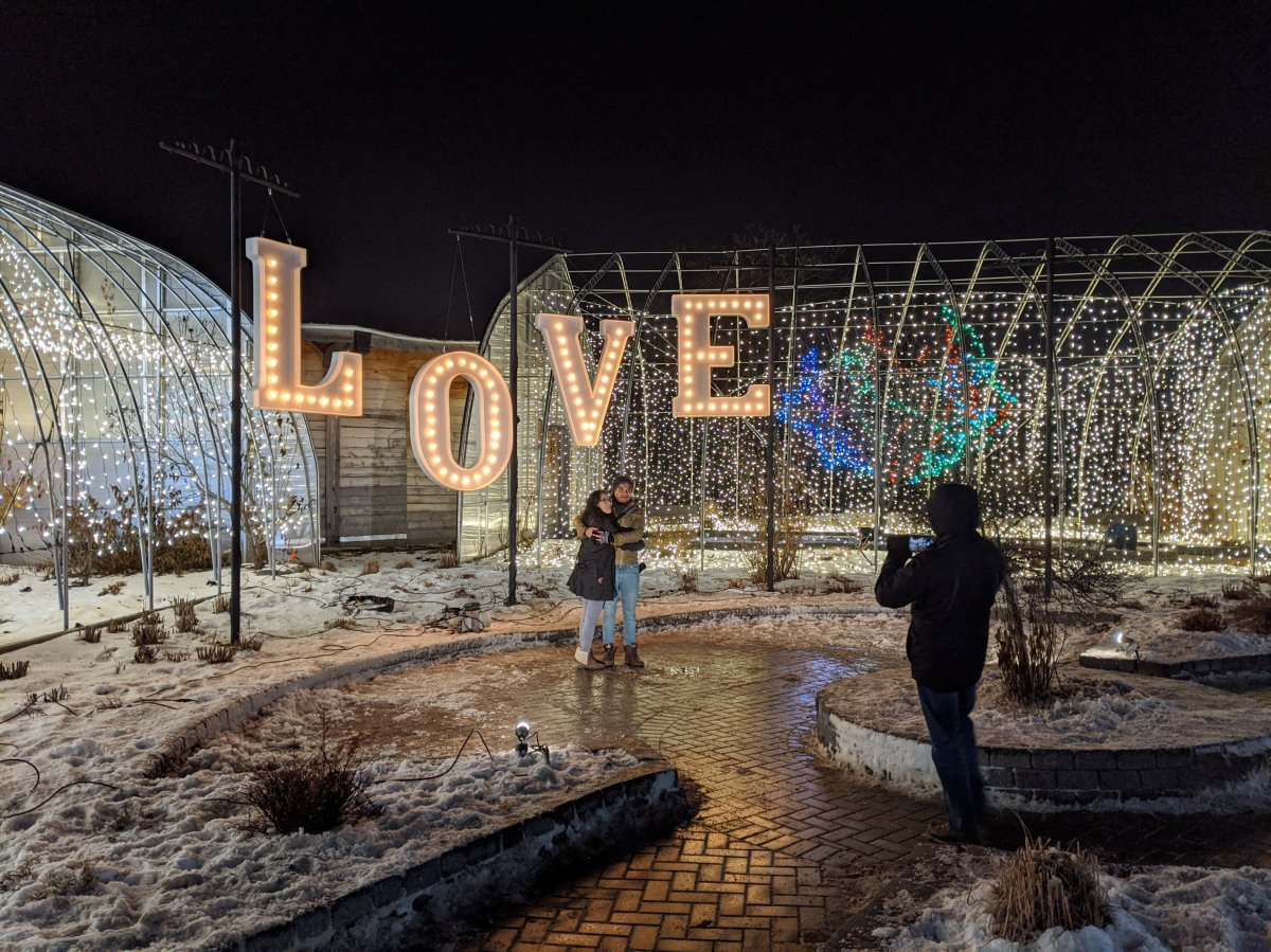 Zoo patrons pose for a photo at last year's Zoo Lights display.