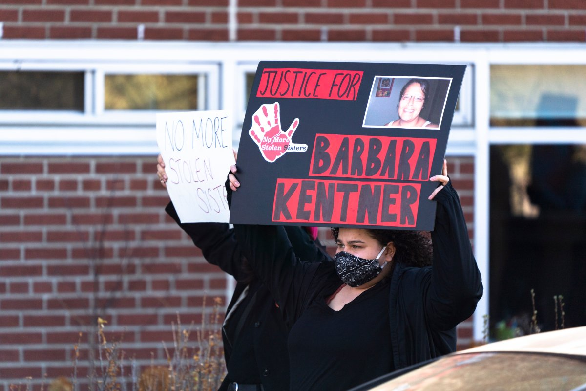 """Protesters under the """"Not One More Death"""" banner march toward the old courthouse ahead of the second day of the manslaughter trial for Brayden Bushby in Thunder Bay, Ont., Tuesday, Nov. 3, 2020. Bushby, 21, threw a trailer hitch at Barbara Kentner, a First Nations woman who died several months after the 2017 assault."""