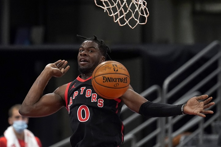 Toronto Raptors guard Terence Davis (0) follows through on a dunk against the Miami Heat during the first half of an NBA basketball game Wednesday, Jan. 20, 2021, in Tampa, Fla.