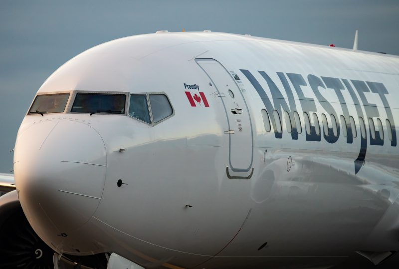A WestJet Airlines Boeing 737 Max aircraft taxis to a gate after arriving at Vancouver International Airport in Richmond, B.C., on Thursday, January 21, 2021.