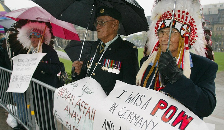 First Nation veterans of the Second World War Howard Anderson, right to left, Philip Favel and Henry Beaudry protest to save their veteran's benefits at the arrivals for the throne speech in Ottawa on Sept. 30, 2002.