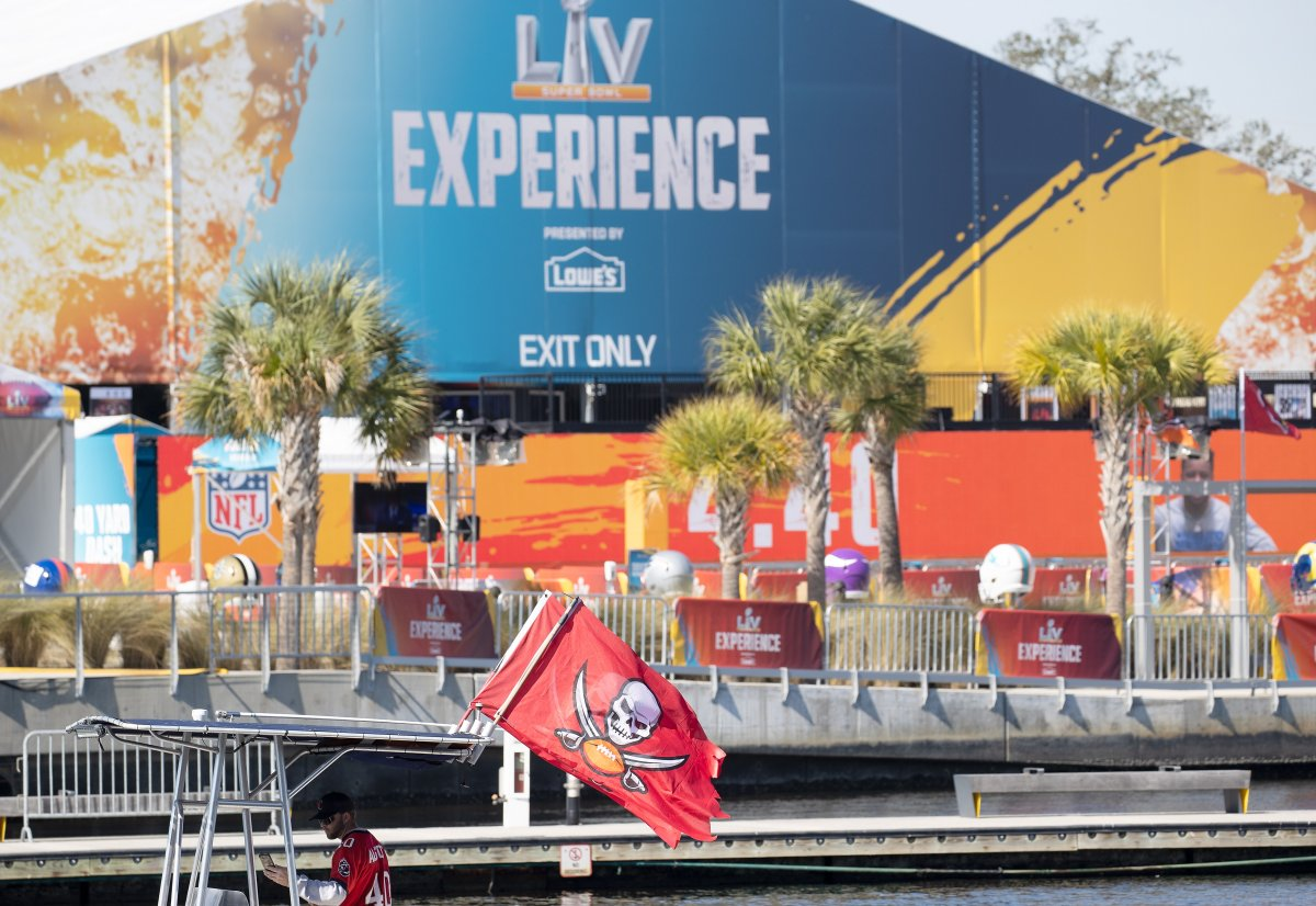 A Tampa Bay Buccaneers fan displays a flag on his boat as he passes the Super Bowl Experience compound, ahead of the NFL Super Bowl LV in Tampa, Florida.