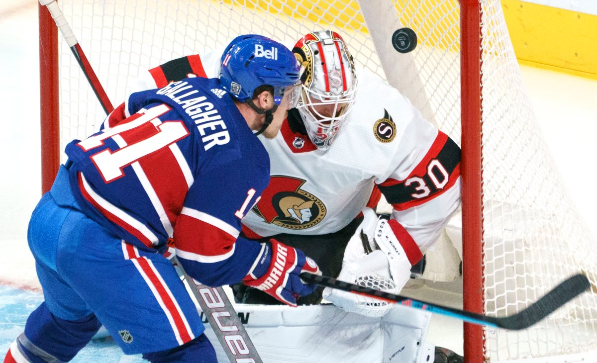 Ottawa Senators goaltender Matt Murray loses sight of the puck as Montreal Canadiens' Brendan Gallagher waits for the rebound during second period NHL hockey action in Montreal on Thursday, February 4, 2021. THE CANADIAN PRESS/Paul Chiasson.