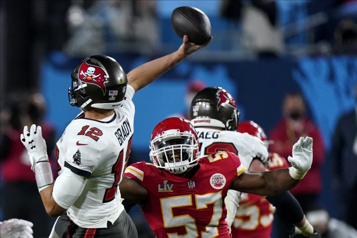 Tampa Bay Buccaneers Tom Brady passes under pressure from Kansas City Chiefs defensive end Alex Okafor during the second half of the NFL Super Bowl 55 football game, Sunday, Feb. 7, 2021, in Tampa, Fla.