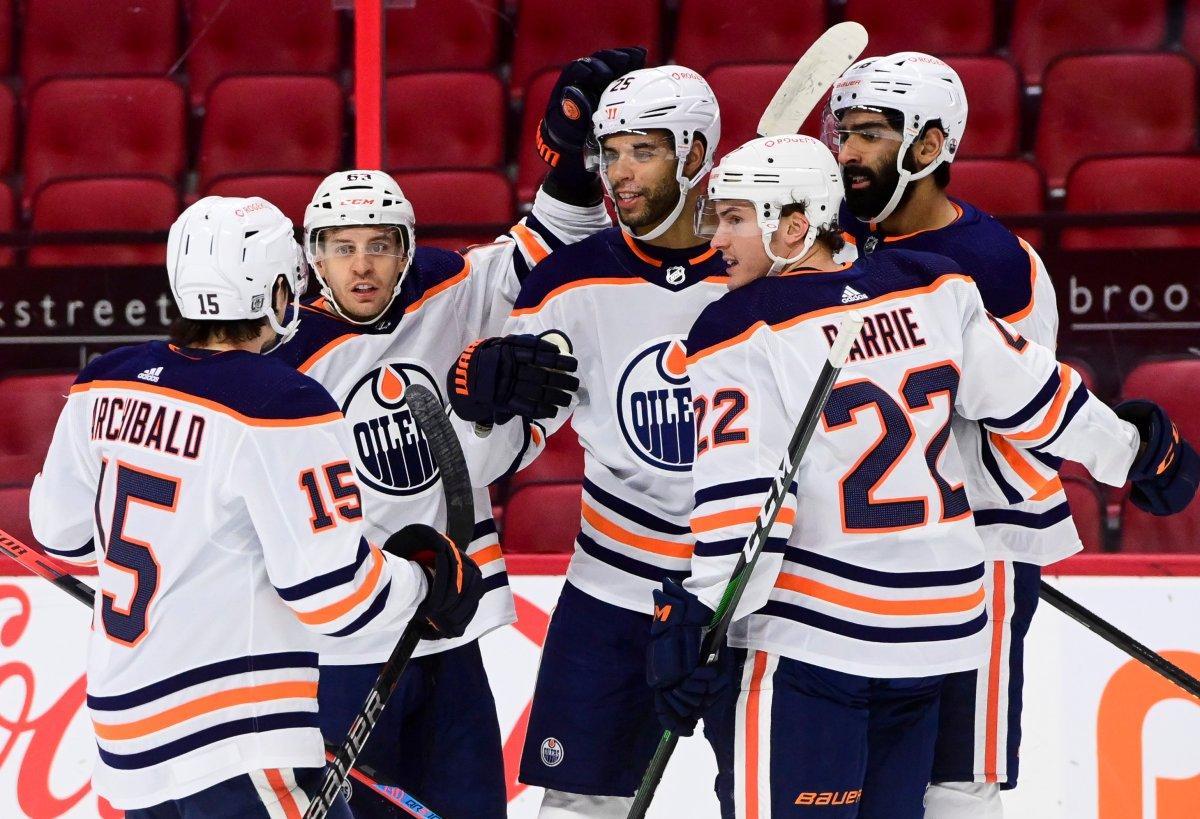 Edmonton Oilers defenceman Darnell Nurse (25) celebrates a goal with teammates while taking on the Ottawa Senators during first period NHL action in Ottawa on Tuesday, Feb. 9, 2021.