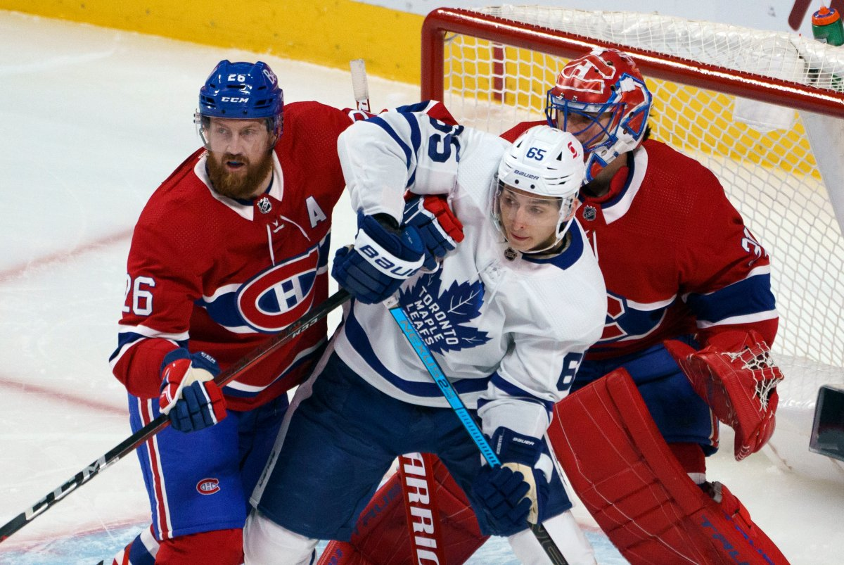 Montreal Canadiens defenceman Jeff Petry battles with Toronto Maple Leafs' Ilya Mikheyev in front of goaltender Carey Price during first period NHL hockey action in Montreal on Wednesday, February 10, 2021. THE CANADIAN PRESS/Paul Chiasson.