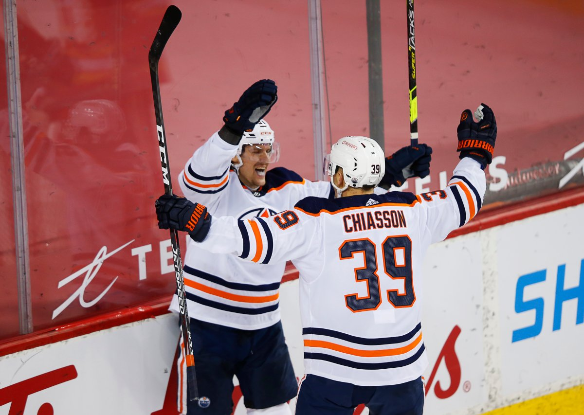 Edmonton Oilers' Gaetan Haas (L) celebrates his goal with teammate Alex Chiasson against the Calgary Flames during the second period of their NHL hockey game in Calgary, Friday, Feb. 19, 2021.THE CANADIAN PRESS/Todd Korol.