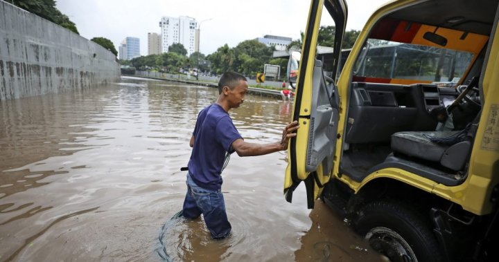 Monsoon flooding in Indonesia's capital forces over 1,300 to flee their homes