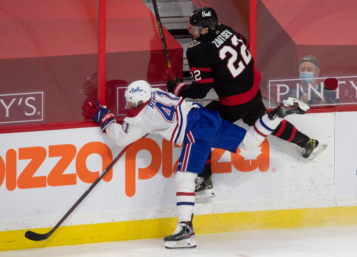 Ottawa Senators defenceman Nikita Zaitsev (22) and Montreal Canadiens left wing Paul Byron Montreal Canadiens left wing Paul Byron (41) collide along the boards during second period NHL action Sunday February 21, 2021 in Ottawa.