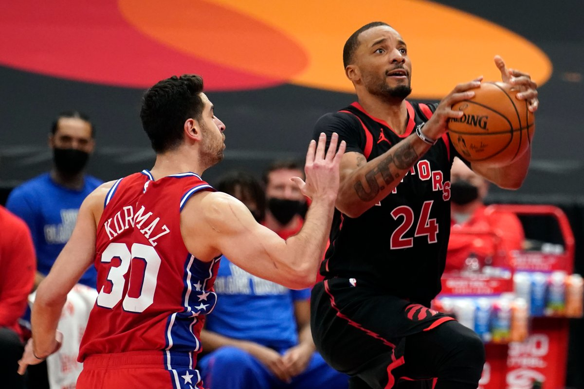 Toronto Raptors guard Norman Powell (24) goes to the basket ahead of Philadelphia 76ers guard Furkan Korkmaz (30) during the second half of an NBA basketball game Tuesday, Feb. 23, 2021, in Tampa, Fla.