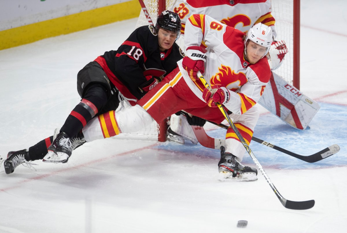 Calgary Flames defenceman Juuso Valimaki battles with Ottawa Senators left wing Tim Stutzle in front of the net during second period NHL action Thursday, February 25, 2021 in Ottawa. T.