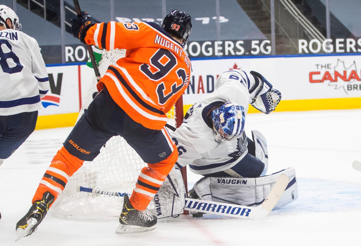 Edmonton Oilers' Ryan Nugent-Hopkins (93) is stopped by Toronto Maple Leafs goalie Jack Campbell (36) during second period NHL action in Edmonton on Saturday, February 27, 2021.THE CANADIAN PRESS/Jason Franson.