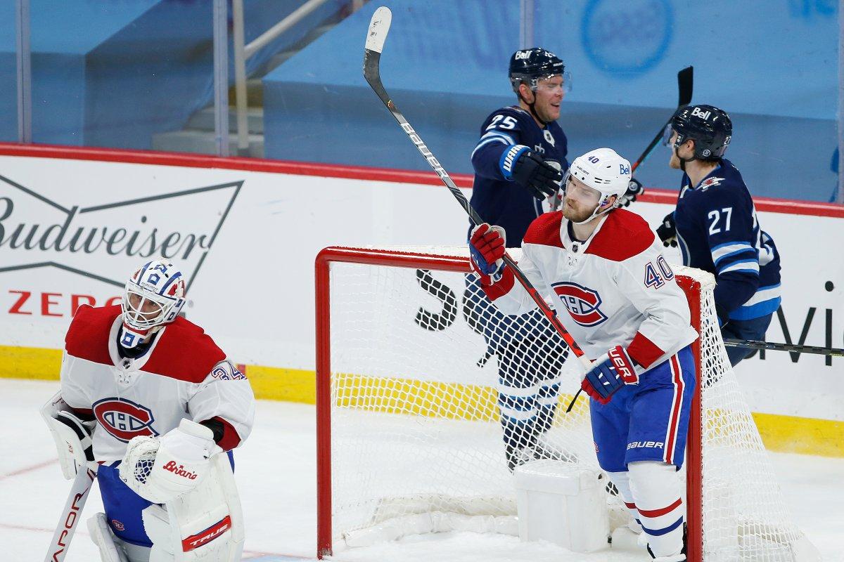 Winnipeg Jets' Paul Stastny (25) and Nikolaj Ehlers (27) celebrate Stastny's game winning goal against Montreal Canadiens goaltender Jake Allen (34) and Joel Armia (40) in overtime NHL action in Winnipeg on Saturday, February 27, 2021.