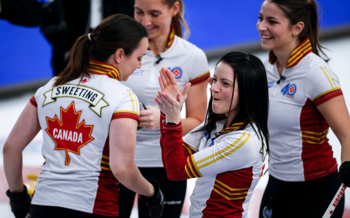 Team Canada skip Kerri Einarson, centre, celebrates after defeating Team Ontario in the final at the Scotties Tournament of Hearts in Calgary, Alta., Sunday, Feb. 28, 2021.
