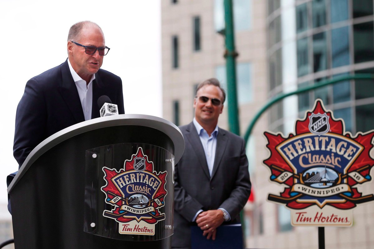 File: Edmonton Oilers Vice Chair Oilers Entertainment Group/Alternate Governor Kevin Lowe, left, announces the Edmonton Oilers alumni roster as Winnipeg Jets alumnus Dale Hawerchuk listens in at a Tim Hortons NHL Heritage Classic press event at Winnipeg's Portage and Main intersection on Friday, August 5, 2016.