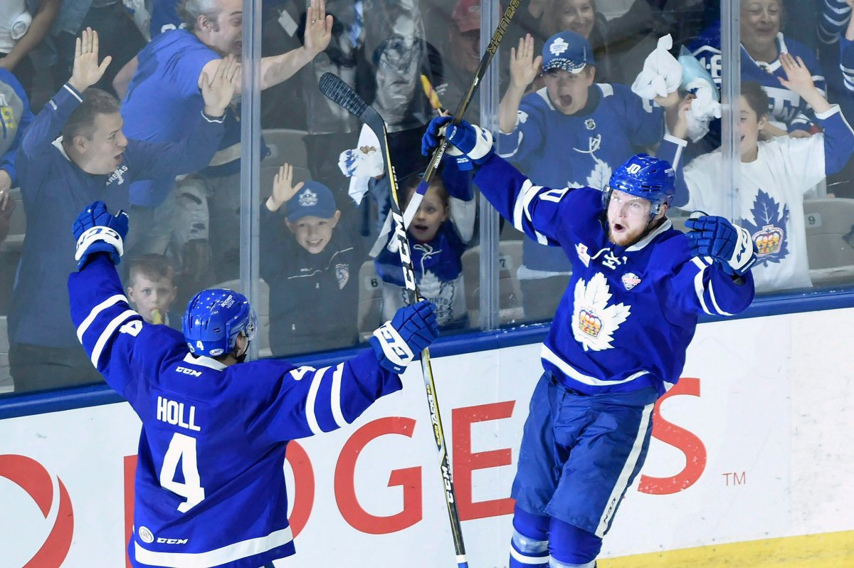 Toronto Marlies' Carl Grundstrom celebrates his goal with teammate Justin Holl (4) during third period AHL Calder Cup playoff action against the Texas Stars in Toronto on Thursday June 14, 2018. The Marlies and the Belleville Senators were given the green light to play in the AHL Canadian division on Friday, Feb. 12, 2021.