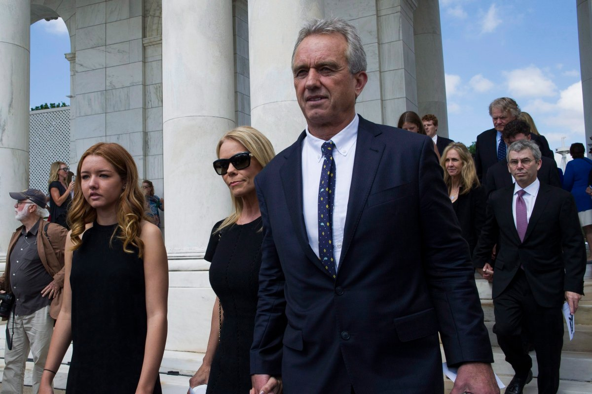 Robert F. Kennedy, Jr. and his wife Cheryl Hines, center, arrive for the Celebration of the Life of Robert F. Kennedy at Arlington National Cemetery in Arlington, Wednesday, June 6, 2018.