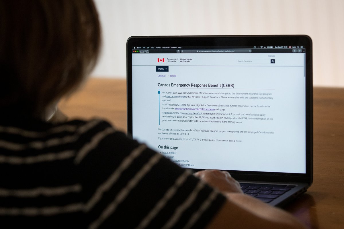 A person looks at the Government of Canada's website for Canada Emergency Response Benefit (CERB) in Kingston, Ontario on Sunday, September 27, 2020.