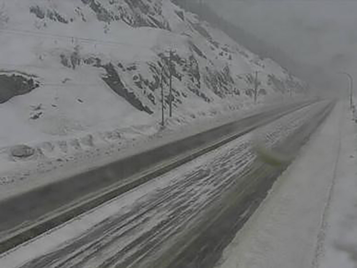 Road and weather conditions at the summit of the Coquihalla Highway on Thursday, Feb. 4, 2021. Environment Canada says an incoming weather system will spread snow over the region, with mountain passes receiving between 20 and 30 centimetres of snow by Friday morning.