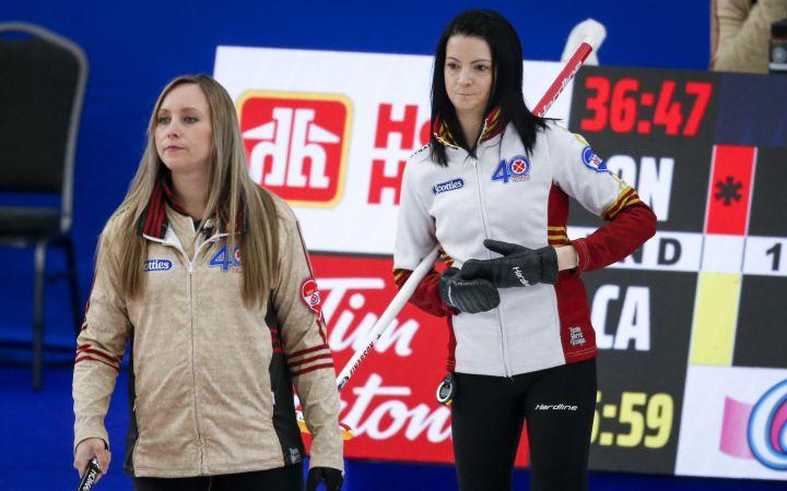 Team Ontario skip Rachel Homan, left, directs her team as Team Canada skip Kerri Einarson looks on at the Scotties Tournament of Hearts in Calgary, Alta., Thursday, Feb. 25, 2021.