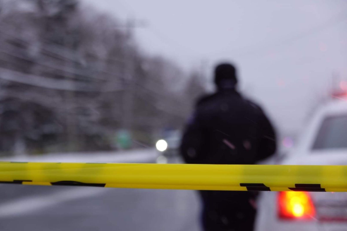 File - Crime scene tape is strung along Mount Edward Rd. in Dartmouth on Feb. 20, 2021.