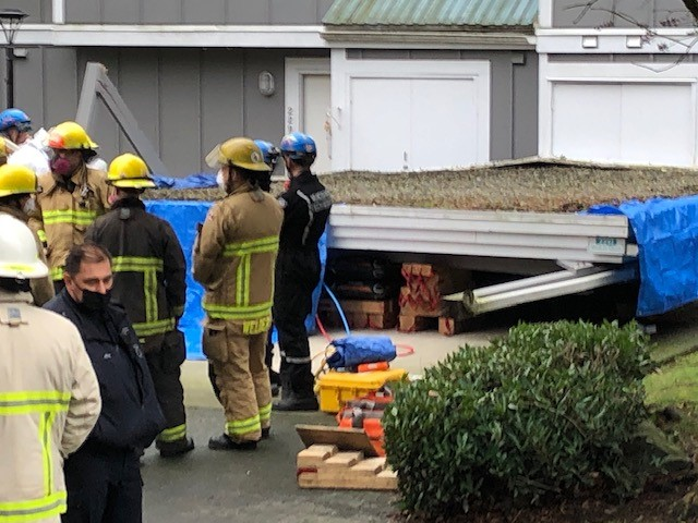 Delivery man dead after unattended truck collapses a carport - image