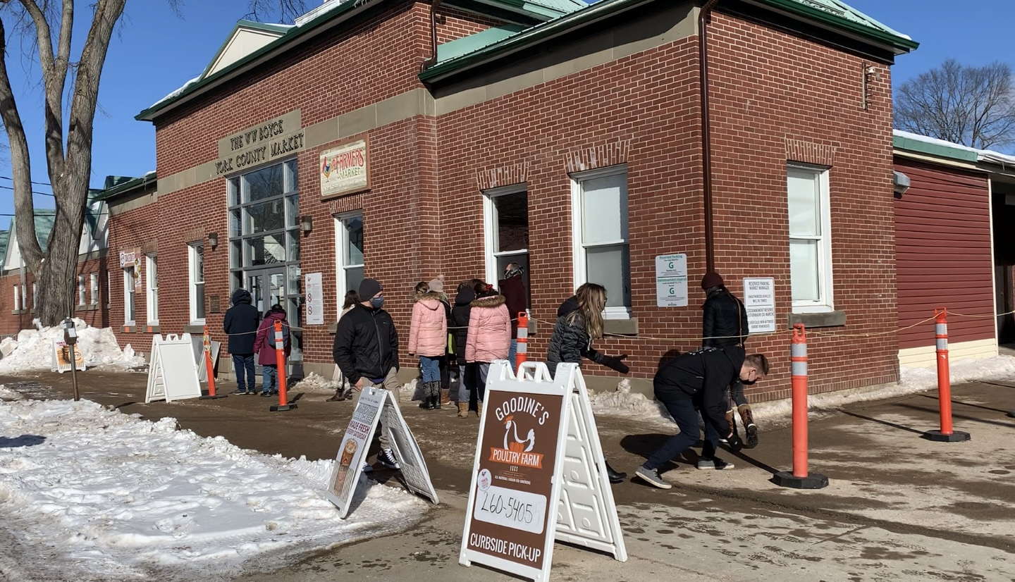 On a sunny cold Saturday morning locals line up outside the Fredericton Boyce Farmers Market.