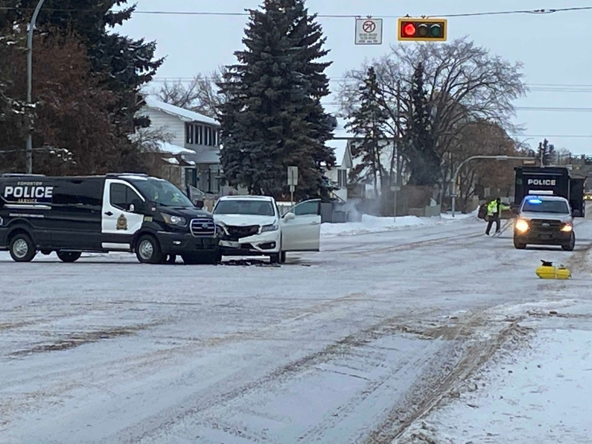 One person was taken to hospital after a collision between an SUV and a marked police van on Feb. 12, 2021.