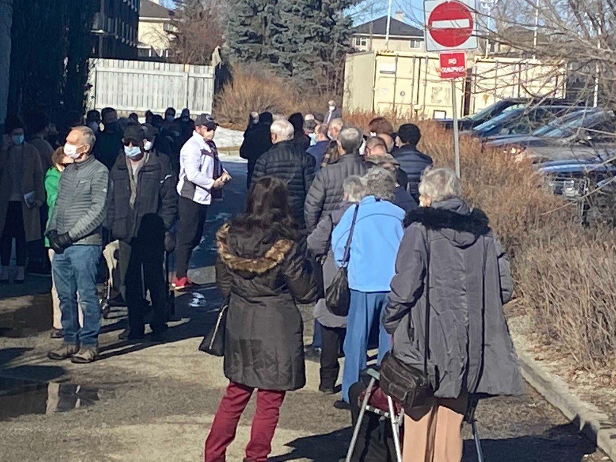 Seniors were greeted with long lines and lengthy waits on Day 2 of Phase 2A of Alberta's COVID-19 vaccine plan on Feb. 25, 2021.