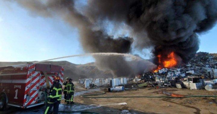 Kamloops fire crews battle massive scrapyard blaze generating toxic smoke