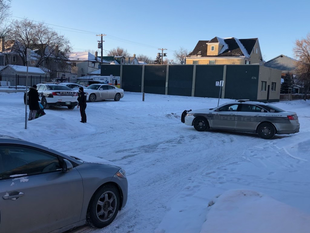 Police remain on scene in the 600 block of McGee Street  Saturday executing a warrant.