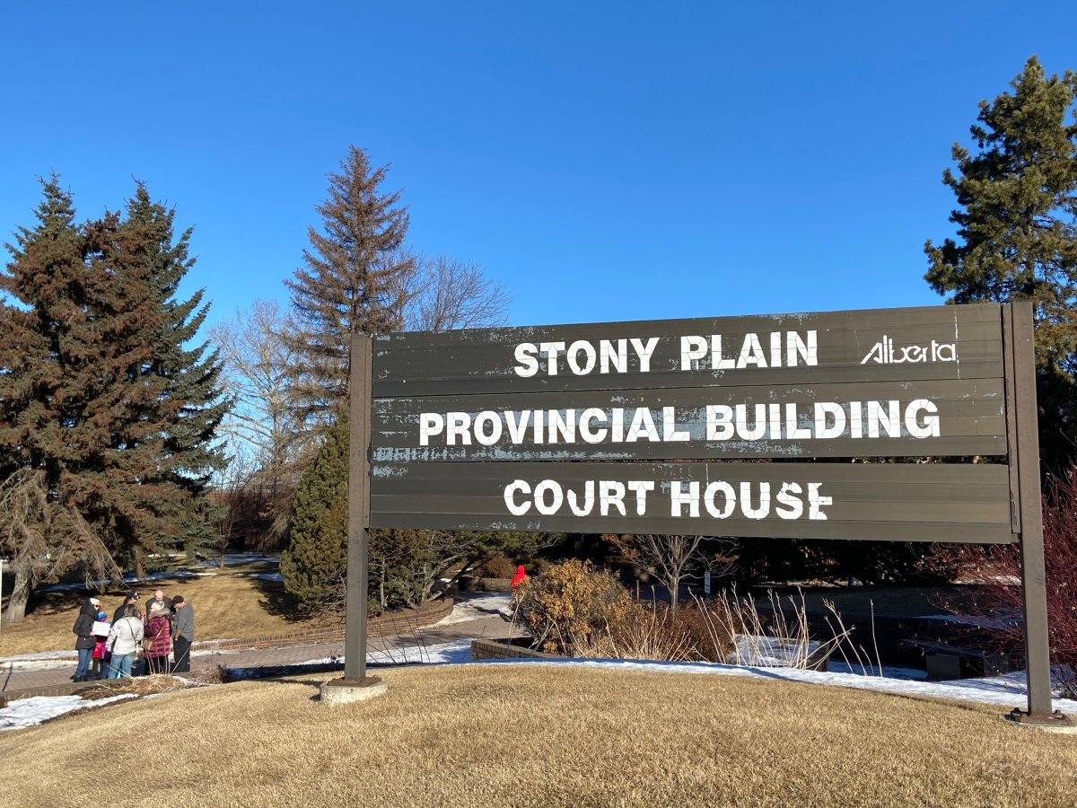Supporters gather outside the courthouse in Stony Plain for pastor James Coates Wednesday, Feb. 24, 2021.