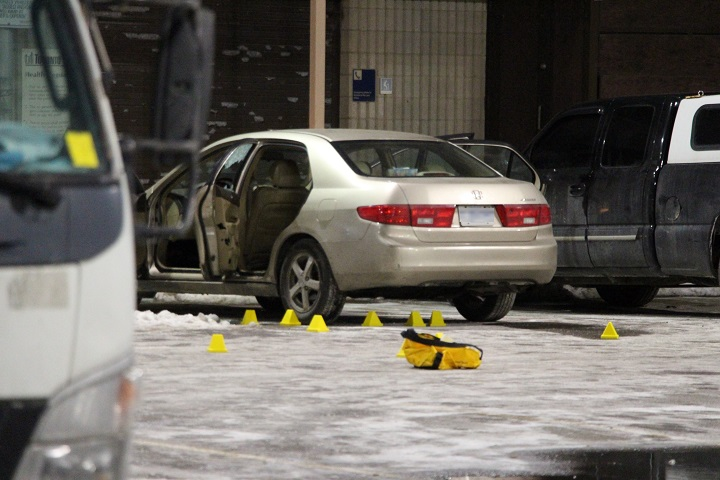 Police gathered evidence at a car at an Oak Street parking lot early Wednesday.