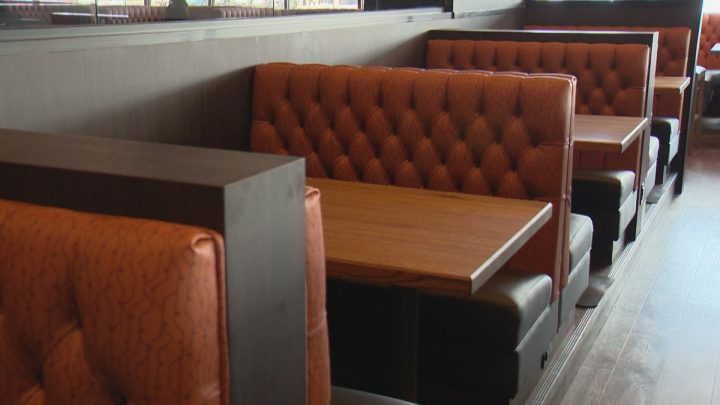 Empty booths are seen at the Rotisserie buffet in Regina.