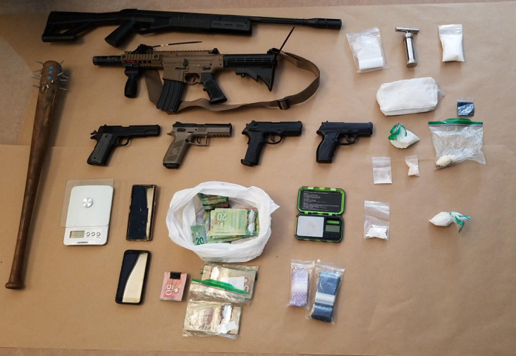 Kingston police executed three search warrants Wednesday, resulting in the seizure of drugs, weapons and cash.
