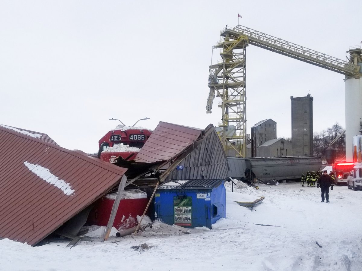 The runaway freight train derailed and crashed into a small building nearby.