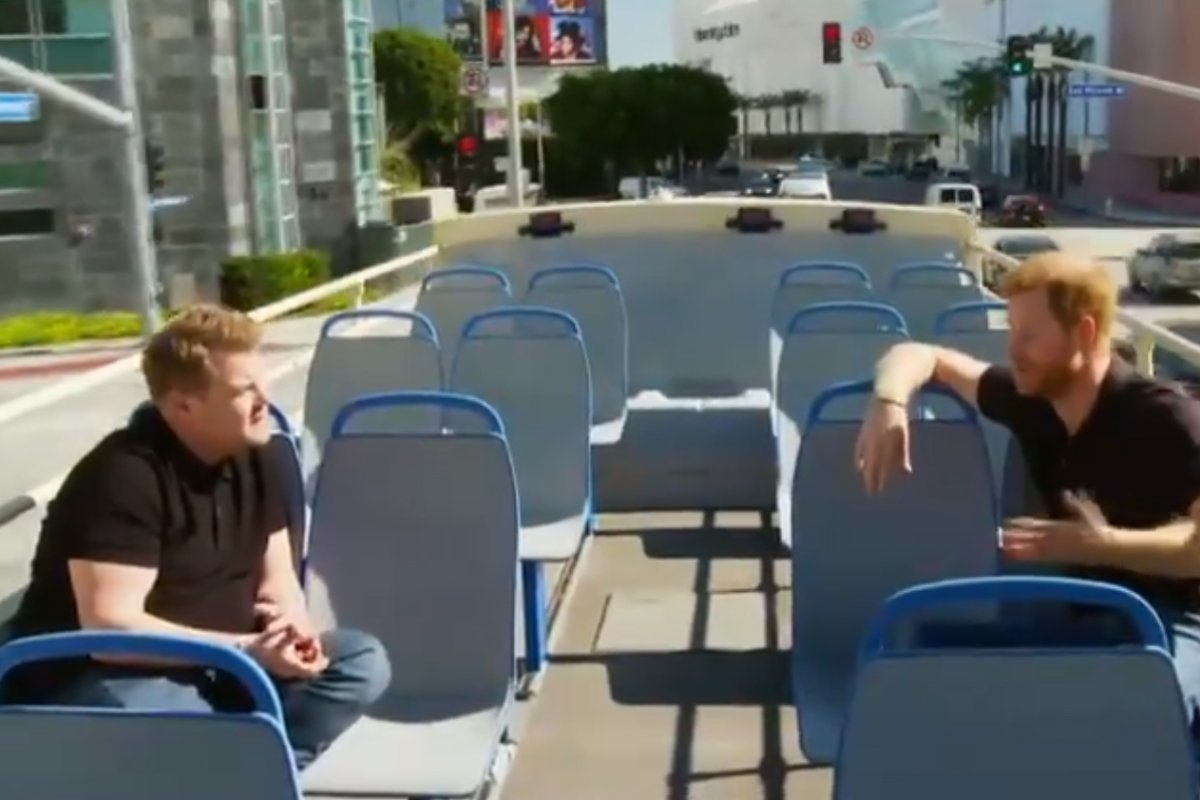 TV host James Corden, left, interviews Prince Harry on a bus in Los Angeles in this image from video aired on CBS' 'Late Late Show' Feb. 25, 2021.