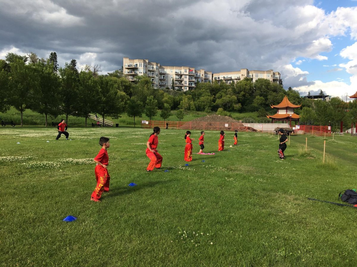 Students from Edmonton Hung Mon Athletic Club practising outdoors.