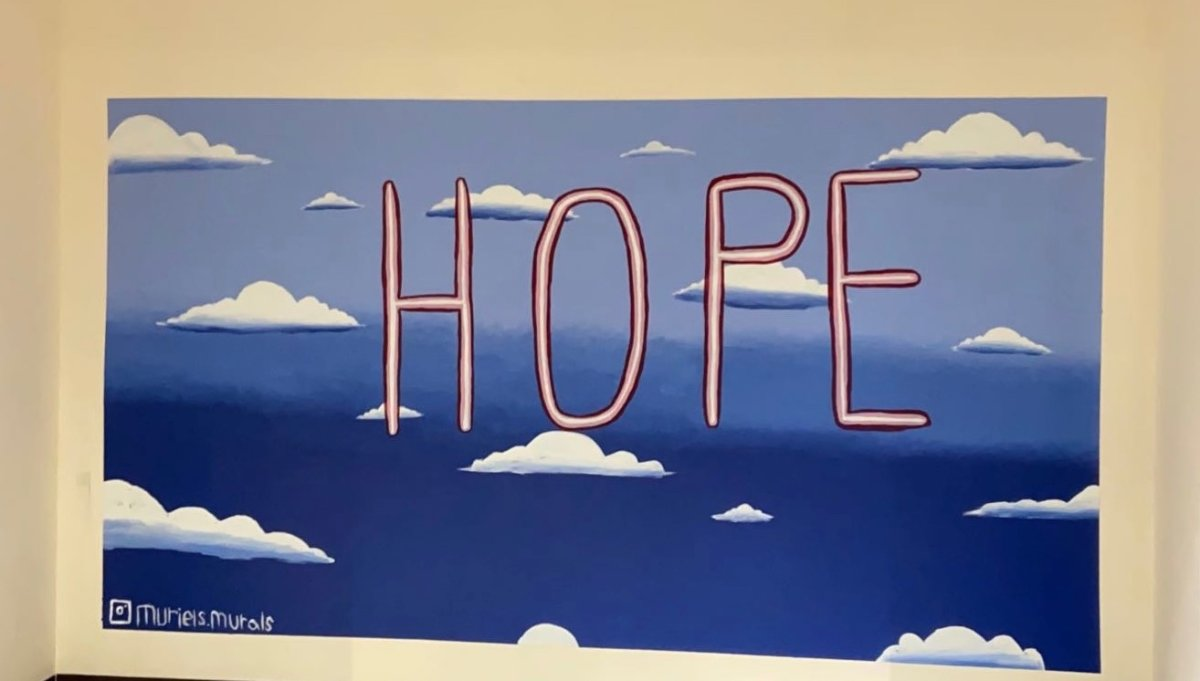 Muriel Charlebois, 14, painted a HOPE mural at the COVID-19 testing site at Calgary's old Greyhound bus station.