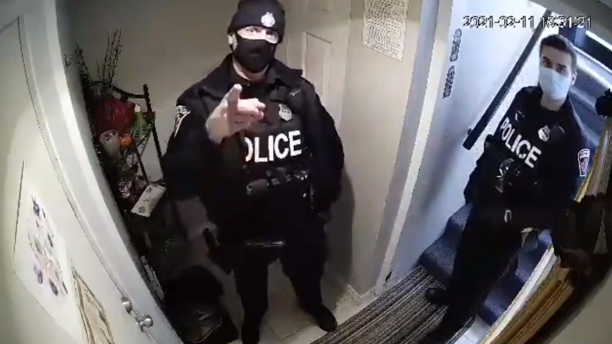 Hamilton police say they have forwarded a video to their professional standards department in which an officer lunged at a woman amid a call related to a dispute with a neighbour on Feb. 11, 2021.