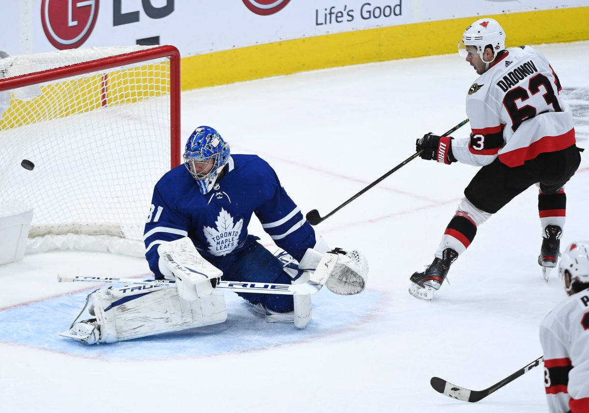 Ottawa Senators right wing Evgenii Dadonov (63) scores the game winning goal past Toronto Maple Leafs goaltender Frederik Andersen (31) during overtime NHL hockey action in Toronto on Monday, February 15, 2021.