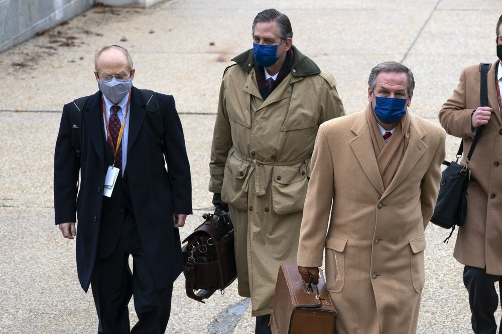 From left, David Schoen, Bruce Castor and Michael van der Veen, lawyers for former President Donald Trump, arrive at the Capitol on the third day of the second impeachment trial of Trump in the Senate, Thursday, Feb. 11, 2021, in Washington.