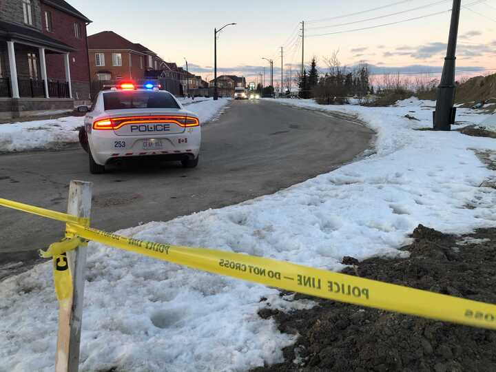 A photo of police on scene near Van Kirk Drive and Mayfield Road in Brampton.