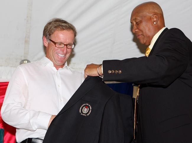 Rheal Cormier receives his jacket from Ferguson Jenkins during his induction to the Canadian Baseball Hall of Fame, Saturday June 23, 2012 in St. Marys, Ontario. Born in Cape Pele, N.B. Cormier pitched for 16 big-league seasons, the third most by a Canadian.